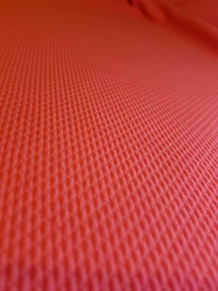 Zoom sur le tissu du top